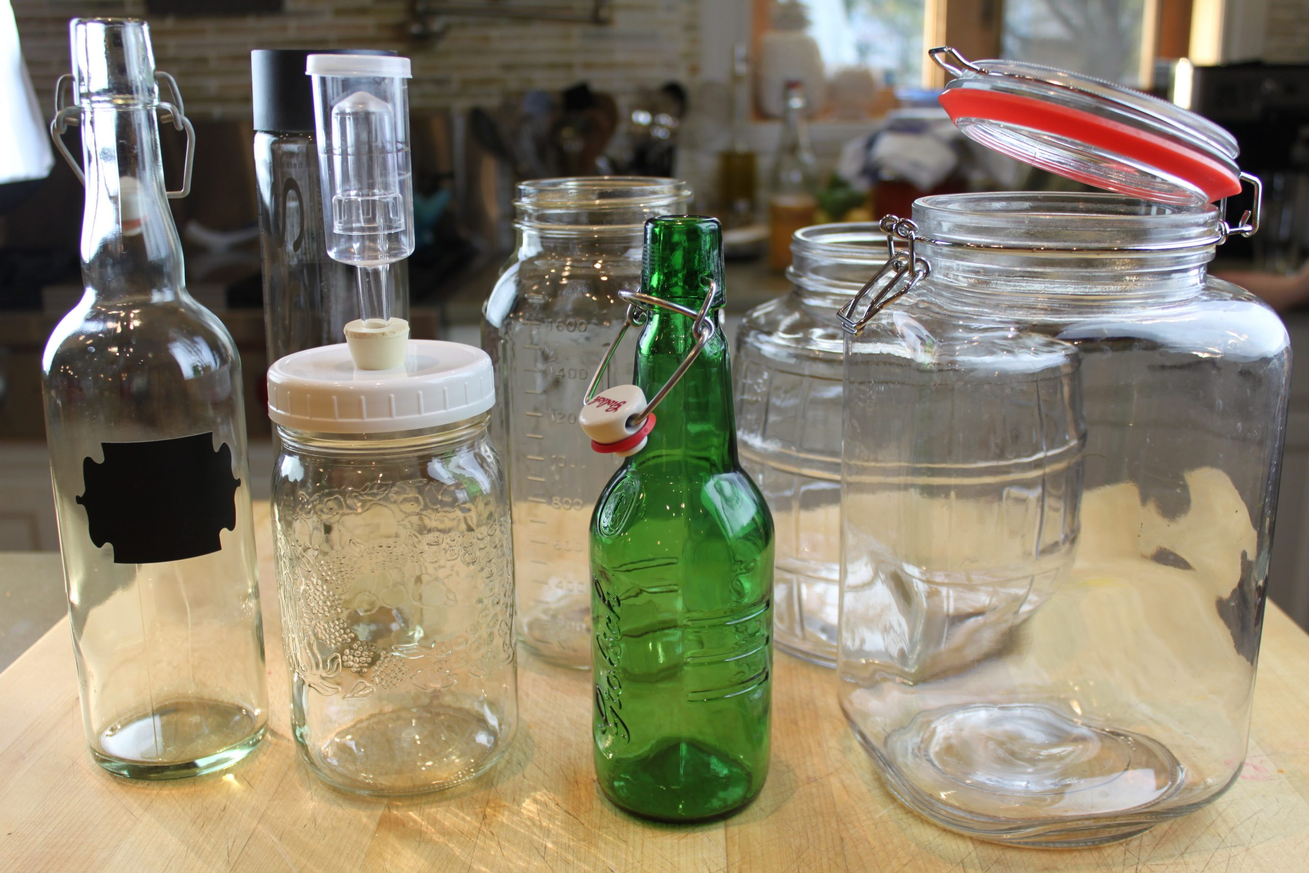 a range of bottles and jar types that are used to do fermentation