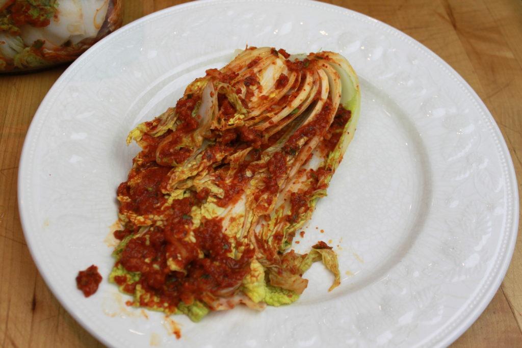 applying-kimchi-paste-to-cabbage