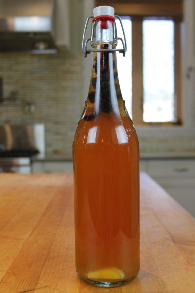 Blackberry kombucha in a flip top bottle