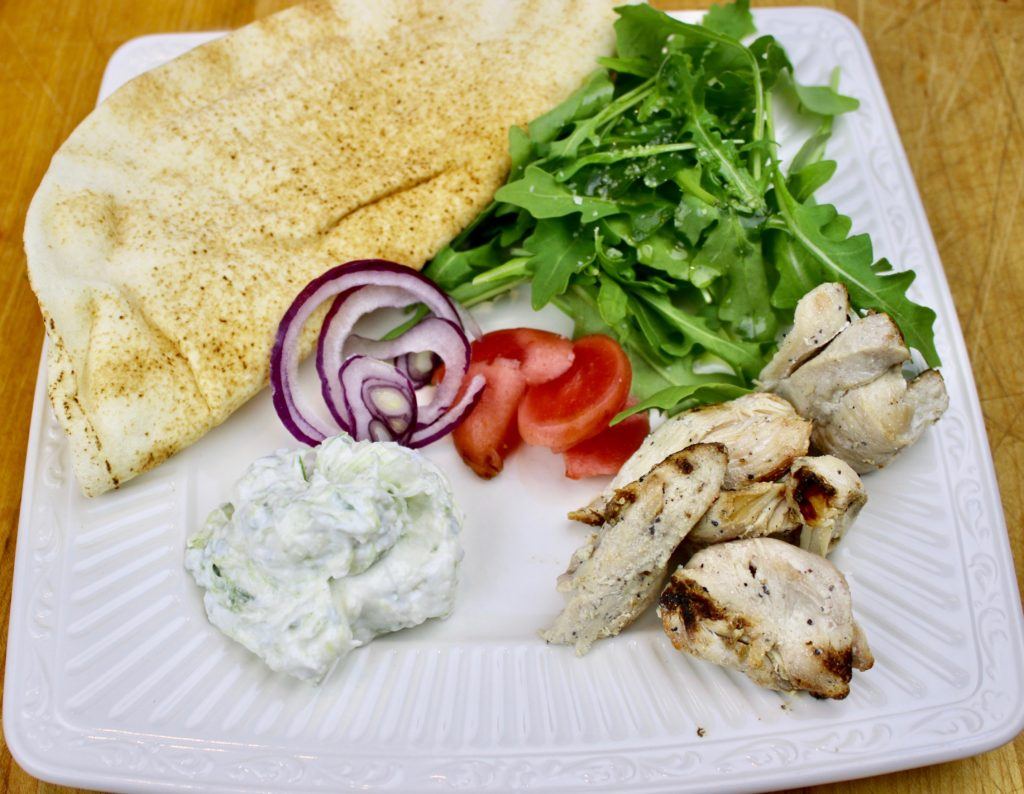 Milk kefir tzatziki with lacto-fermented radishes, grilled chicken and arugula