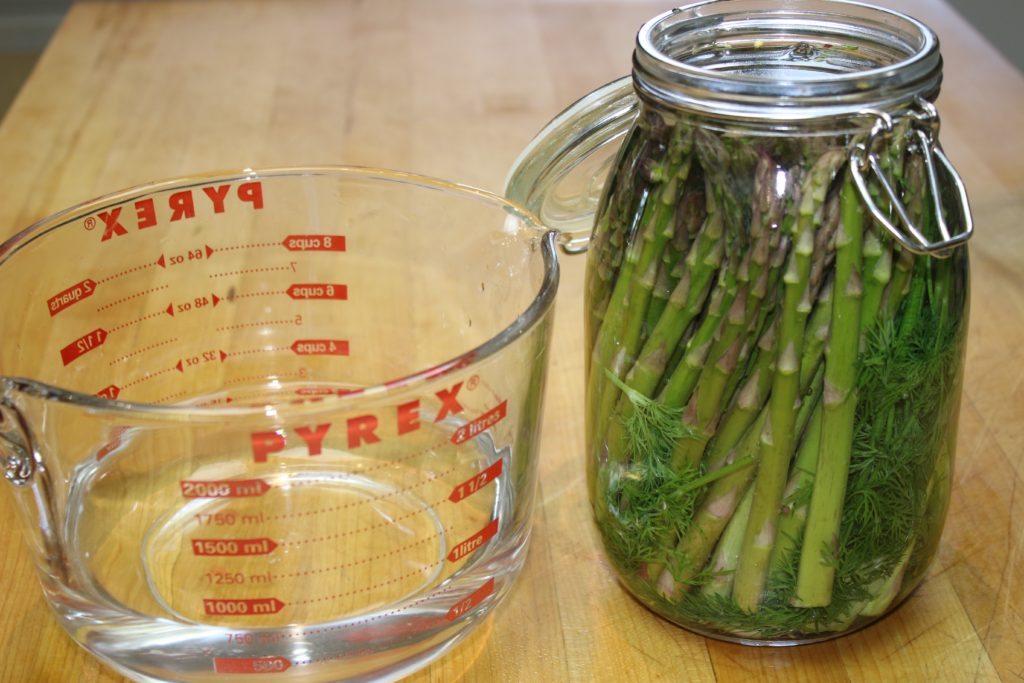 Completely cover asparagus with brine
